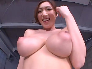 Hugely Boobed Japanese Cougar Sucking a Shaft with Her Boobies Around It