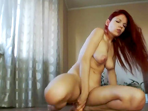 Naughty redhead rides dildo and squirts everywhere