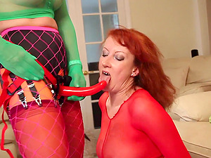 Redhead mature Red gets fucked by a strap on