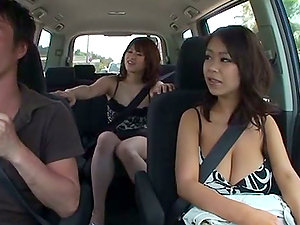 Two huge-chested Japanese ladies give a tit fucking to some dude in a car