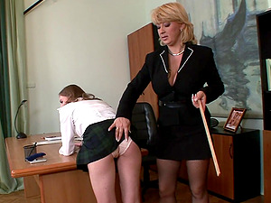 Naughty mistress Madam spanks round ass of slave girl Lolly Cat