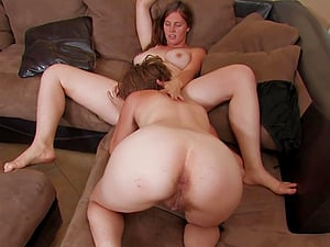 Lesbo sluts with hairy pussies have passionate sex on the sofa