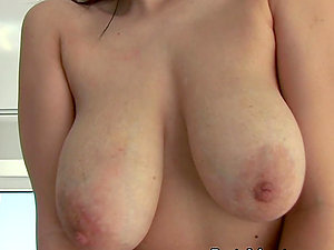 Hot dark-haired shows off her big tits and takes a rail on a penis