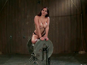 Honey gets her vagina penetrated being tied in the device