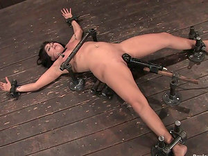 Britney Stevens gets her cootchie toyed while being in fetters