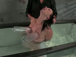 Kinky chick gets toyed and hosed with powerful water jet
