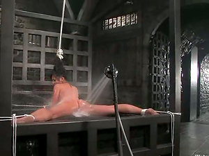 Asian woman gets abased in water restrain bondage flick