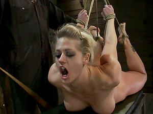 Hog tied Holly Heart gets her beaver toyed in a basement