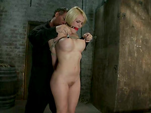 Tied up blonde with big boobies gets her cunt toyed