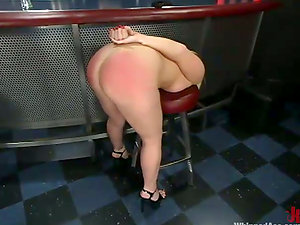 Blonde stunner gets whipped and fucked with a belt cock