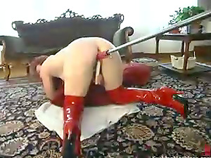 Sandy-haired chick in high boots gets toyed in both fuckholes