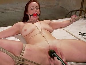 Bella Rossi cums two times while being tormented in a basement