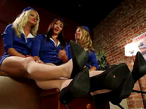 Three sexy flight attendants fuck each other's coochies with their feet