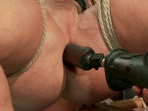 Two muscular faggots get trussed and fall under some torments in a cellar