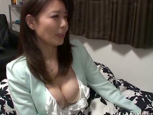Sexy Japanese cougar plays with a dick before taking a good rail on it