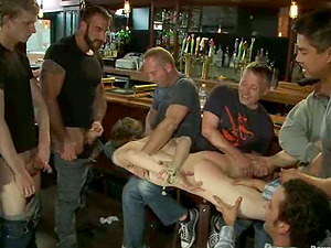 Skinny dude gets bounded and bootie fucked by dudes in a bar