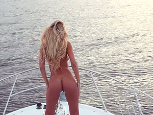 Jennifer Vaughn poses for the webcam on a boat in Playboy backstage vid
