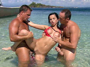 Stunner is lovin? two studs's attention on the beach