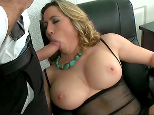 Blonde Honey in Black Stockings Massages Dick With Her Big Tits
