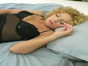 Curly haired bunny is displaying off her sexy shapes